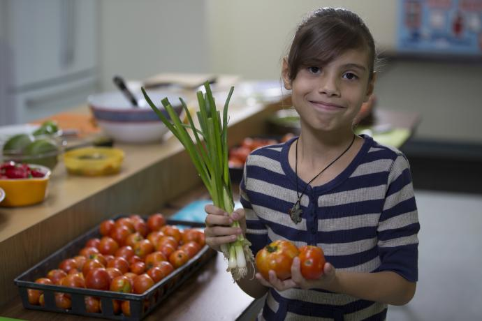 young 4-H girl with vegetables in hand